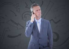 Frustrated business man against grey background and arrow graphics. Digital composite of Frustrated business man against grey background and arrow graphics Stock Images