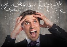 Frustrated business man against grey wood panel and white rain graphics. Digital composite of Frustrated business man against grey wood panel and white rain Stock Photo