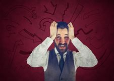 Frustrated business man against maroon background and arrow graphics Stock Photo