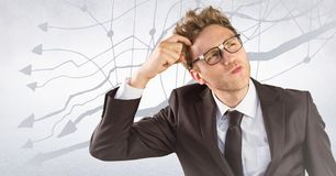 Frustrated business man against white wall and graph Royalty Free Stock Photos