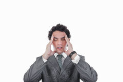 Frustrated business man having severe headache and migraine Stock Image