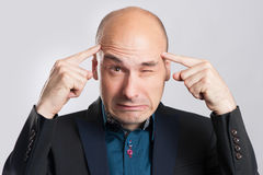 Frustrated business man with a headache Stock Images