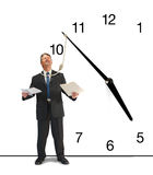 Running out of time business deadline stress. A frustrated business man is minutes away from being hanged by a clock with a noose hanging from it that is around Royalty Free Stock Photo