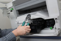Frustrated business man opening photocopy machine in office royalty free stock images