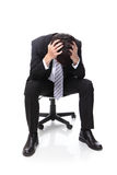 Frustrated business man sitting Royalty Free Stock Photography
