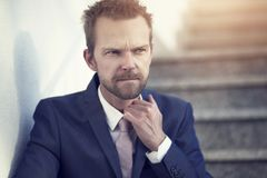 Frustrated business man standing outside Royalty Free Stock Photo