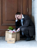 Frustrated business man on street fired asking for help Royalty Free Stock Photography