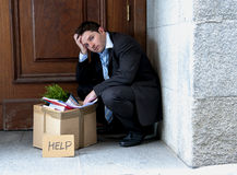 Frustrated business man on street fired asking for help Royalty Free Stock Image