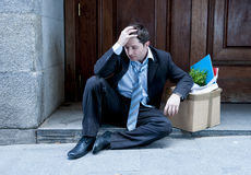 Frustrated business man on street fired with cardboard box Stock Photography