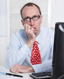 Frustrated business man with tie and glasses at Office. royalty free stock image