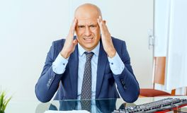 Frustrated business man working at office. Business man is stressed be unemployed , business concept stock photos