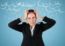 Frustrated business woman against blue background and white rain graphics royalty free stock image