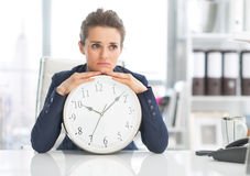 Frustrated business woman with clock Stock Images