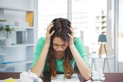 Frustrated business woman at a desk looking down Royalty Free Stock Photo
