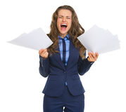 Frustrated business woman with documents Stock Photos