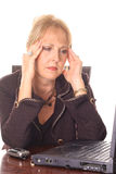 Frustrated business woman with a headache. Photo of a Frustrated business woman with a headache Stock Photo