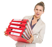 Frustrated business woman holding stack of folders. High-resolution photo Royalty Free Stock Photo