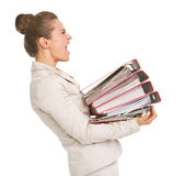 Frustrated business woman holding stack of folders Royalty Free Stock Image