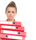 Frustrated business woman holding stack of folders Stock Photography