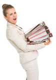 Frustrated business woman holding stack of folders Royalty Free Stock Photo