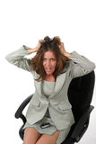 Frustrated Business Woman Pulling Her Hair Out 1. Frustrated executive business woman with a troubled expression sitting in her office chair pulling her hair out Stock Photo