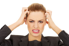 Frustrated business woman screaming. Frustrated and angry business woman screaming loud Stock Images