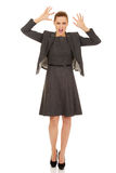 Frustrated business woman screaming. Frustrated and angry business woman screaming loud Royalty Free Stock Image