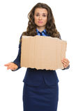 Frustrated business woman showing blank cardboard Royalty Free Stock Images