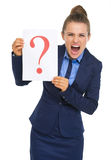 Frustrated business woman showing paper sheet with question mark Stock Photo
