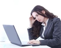Frustrated business woman sitting in front of an open laptop. Photo with copy space royalty free stock photos