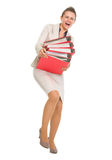 Frustrated business woman with stack of folders Royalty Free Stock Image