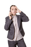Frustrated business woman. Studio shot of a worried and frustrated looking business woman, who is talking on the phone, using her hand to gesture Stock Photography