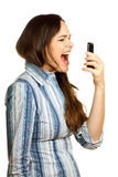 Frustrated business woman yelling at her phone. An angry and very frustrated young business woman yelling at her phone. Isolated over white Stock Photography