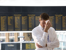 Frustrated businessman in airport stock photography