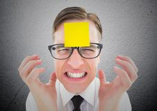 Frustrated businessman with blank sticky note on his forehead Stock Photos