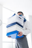 Frustrated businessman carrying boxes Stock Photos