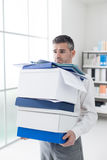 Frustrated businessman carrying boxes Royalty Free Stock Photos