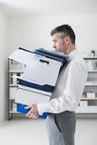 Frustrated businessman carrying boxes Stock Image