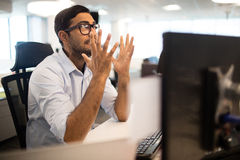 Frustrated businessman clenching teeth in office Stock Images
