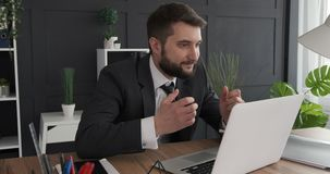 Businessman receiving bad news on laptop. Frustrated businessman closing laptop in anger at office desk stock footage