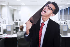 Frustrated businessman cutting his neck Stock Photos