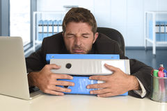 Frustrated businessman desperate face expression suffering stress at office computer desk Stock Image
