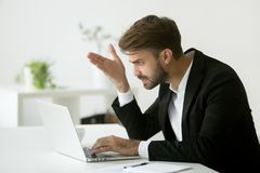 Frustrated businessman disappointed by bad online news Stock Photos