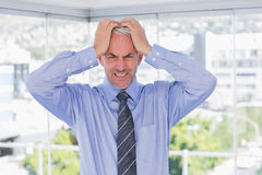 Frustrated businessman with hands on his head Stock Image
