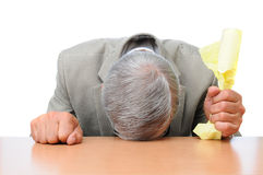 Frustrated Businessman Head on Desk Royalty Free Stock Image