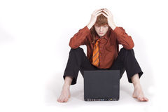 Frustrated businessman with laptop Stock Photography
