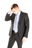 Frustrated businessman looking on disaster. Royalty Free Stock Image