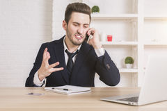 Frustrated businessman on phone Stock Photo