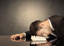 Frustrated businessman's head on keyboard Royalty Free Stock Photography