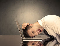 Frustrated businessman's head on keyboard Royalty Free Stock Image
